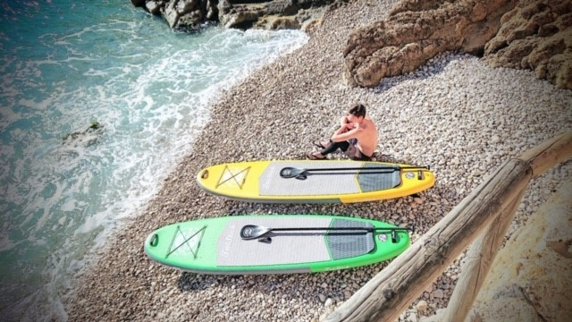 two fatstick inflatable paddleboards on the beach in spain